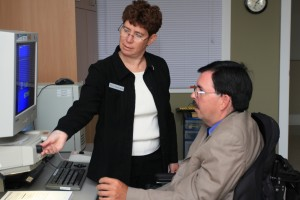 Assistive Technology Specialist working with a Computer Comfort Participant
