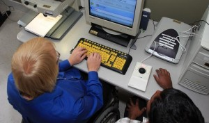 Computer Comfort Participant working with a Volunteer at a Computer Workstation