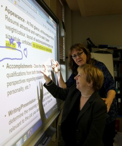 an Employ-Ability Participant reading from a projection screen