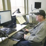 A man sitting at an accessible work station
