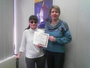 Employ-Ability Participant Lee Ann posing with her graduation certificate and instructor Cheryl Colmer