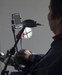 person with a disability using an accessible cell phone