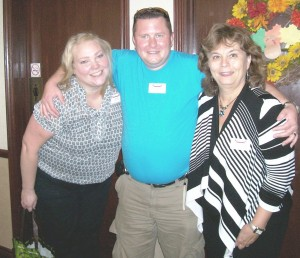 Murray (centre) at Stillwater Creek Retirement Residence with Activity Assistant Jennifer (left) and Activity Director, Diane (right)