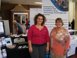 Heather Hughes and Danielle Wylie represent the Neil Squire Society at the University of New Brunswick Volunteer Fair