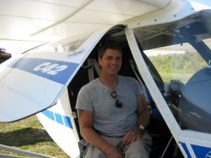 Ben posing in an Ultralight airplane