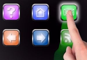 a finger selecting an icon on a computer screen