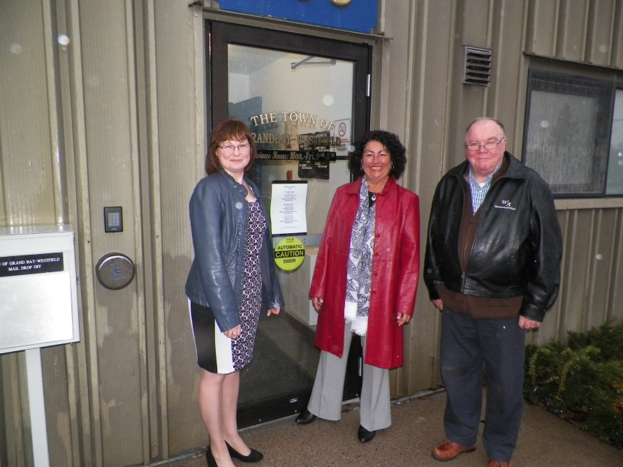 Neil Squire Society's Bev Grasse pictured with Mayor of Grand Bay-Westfield, Grace Losier, and Councillor David Calvin