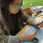 kelly-working-on-a-lipsync-soldering