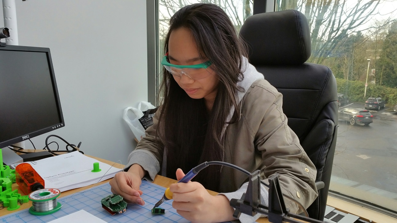 Kelly doing some soldering.