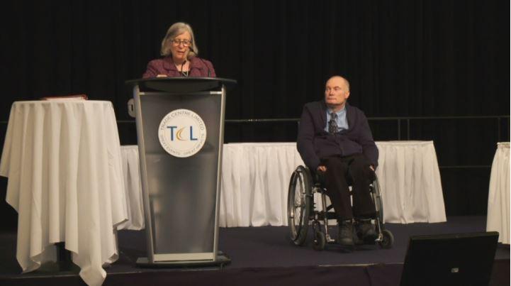 Symposium chair Anne MacRae introduces Dr. Gary Birch