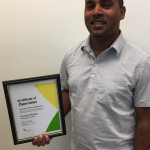 Munesh Rahman with the Community Service Award