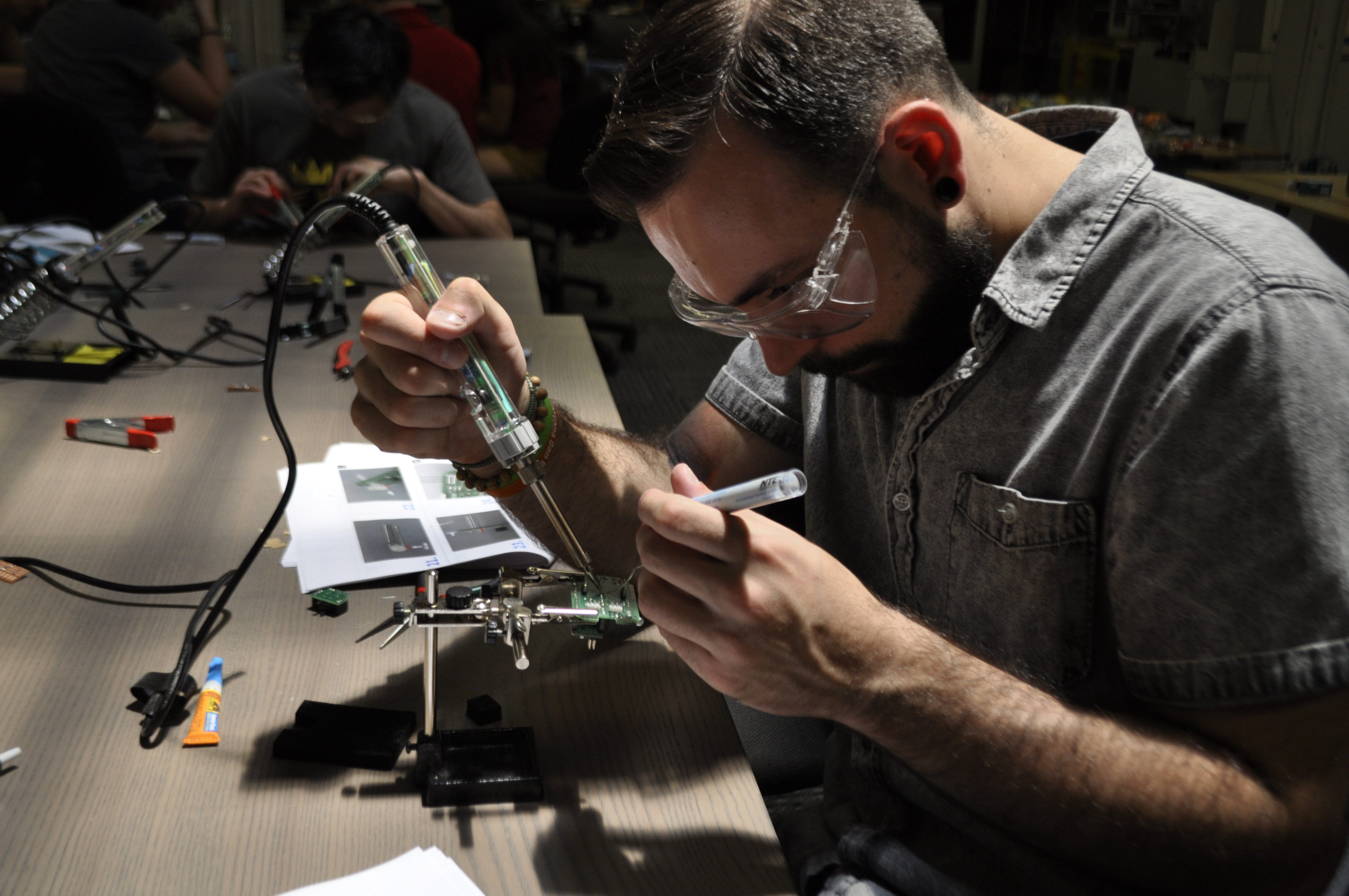 Charles Soldering Together His Circuit Board Neil Squire Society What Solder To Use For Boards