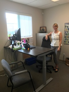 Technology@Work participant, Jodi, at her workstation