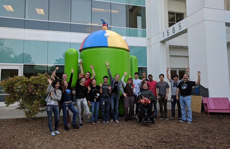 Google and Neil Squire Society staff pose in front of the Android statue at Google HQ