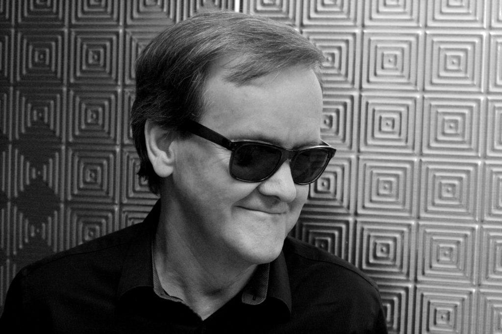 Black-and-white headshot of Roy