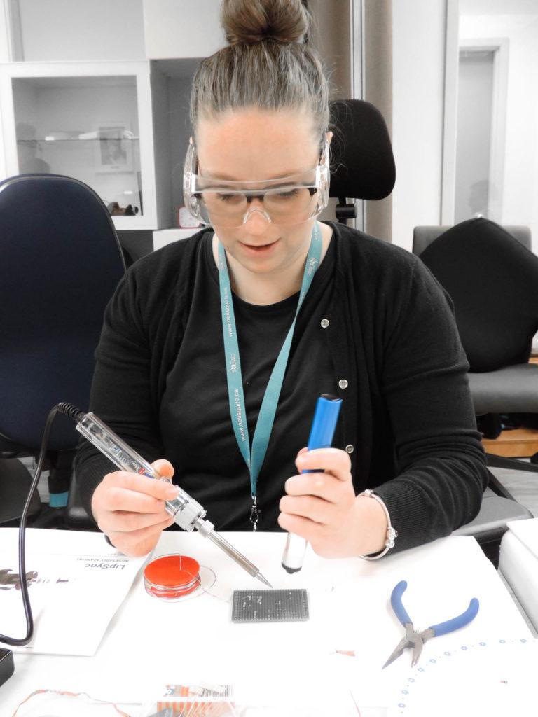 Gemma soldering a LipSync