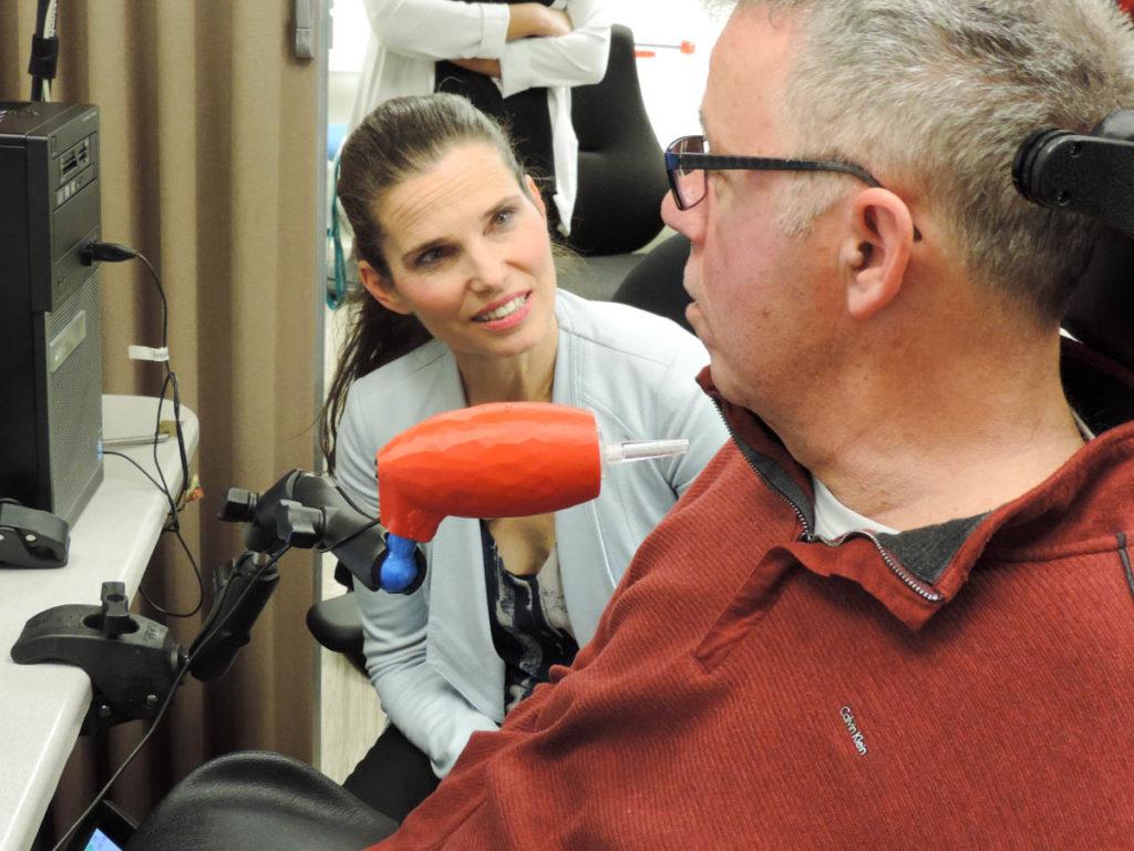 Jim, a quadriplegic, demonstrates the LipSync to Minister Duncan