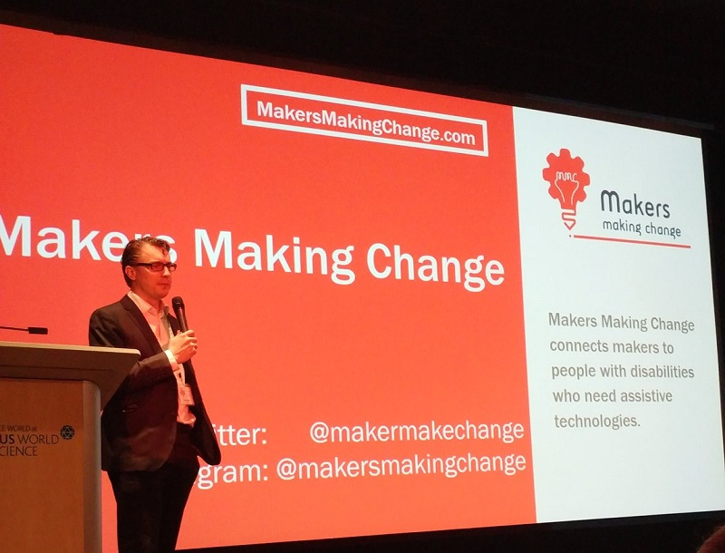 Chad Leaman delivering the keynote at STAN 2018 with a Makers Making Change backdrop