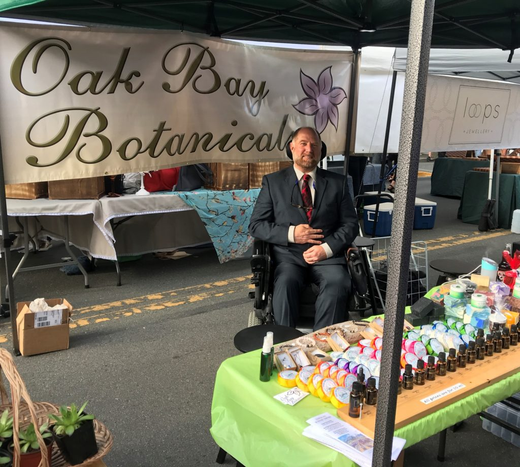 Greg at the Oak Bay Botanicals booth at the Oak Bay Night Market