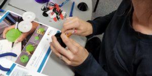 person assembling a pen ball