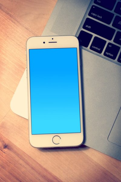 An iPhone on a MacBook