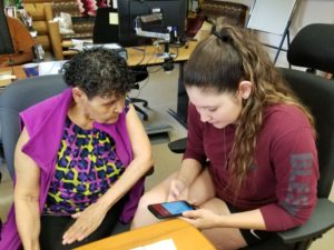 Vanessa (right) tutoring a Band Elder on a smartphone