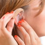 a woman with a hearing aid