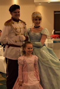 Attendee with Cinderella and Prince Charming