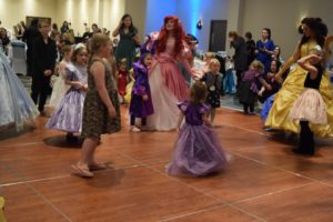 Children dancing with Princesses