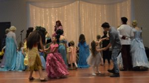 Children dancing with their parents, Princesses, and each other