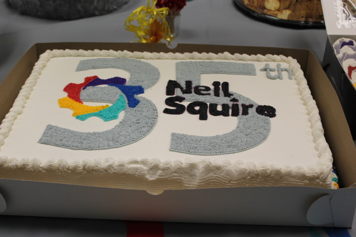 Cake with Neil Squire logo and the number 35