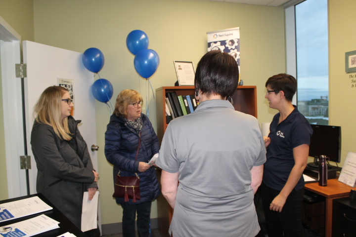 Staff speaking with attendees