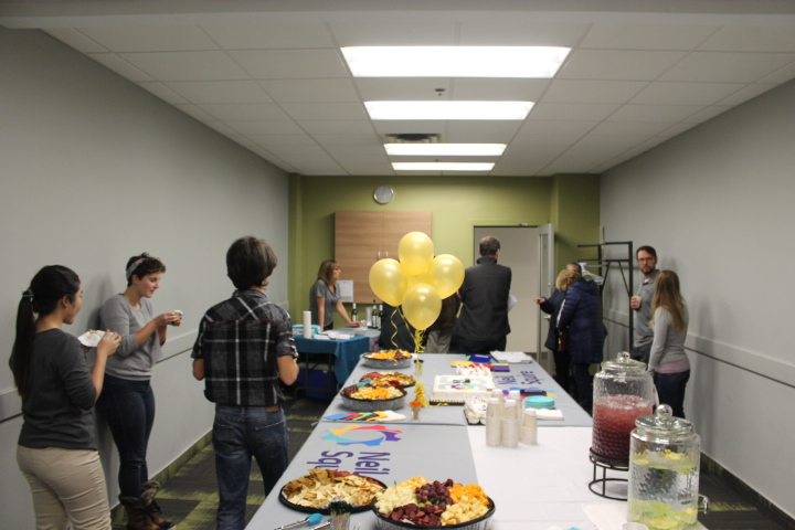 Attendees having food and cake