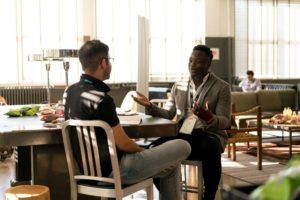two men having a conversation