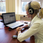 An intern using a headset for one of our virtual platforms in 2011