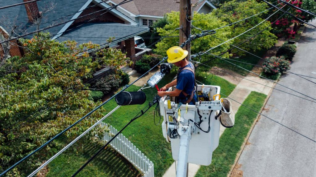 stock image of man repairing electrical wires
