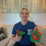 Birk posing with some of the items he printed