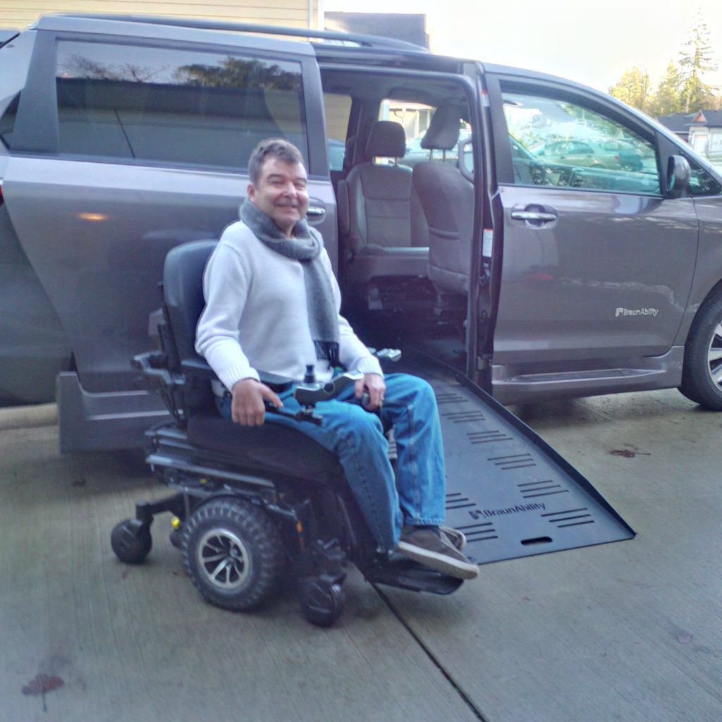 Robert next to his wheelchair accessible van