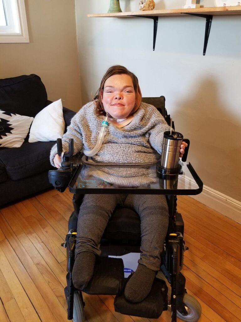 Bonnie using her wheelchair lap tray.