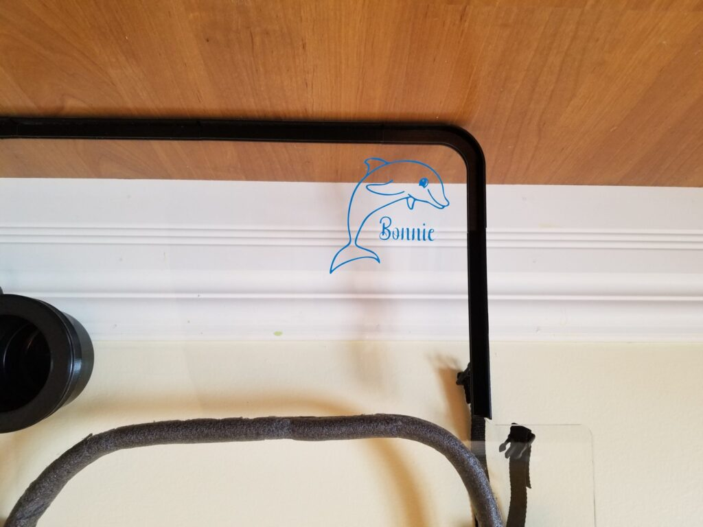 the vinyl decal with the dolphin