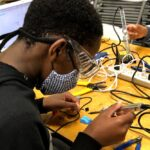 A student soldering their device together