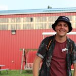 Tyler Fentie smiling in front of a building