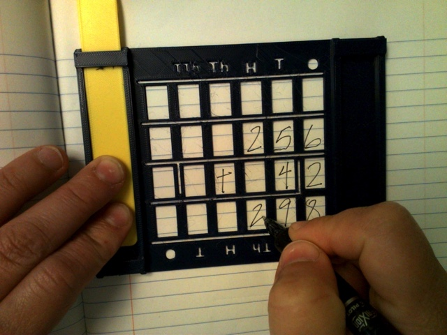 Picture of 3D printed guide for aligning written numbers