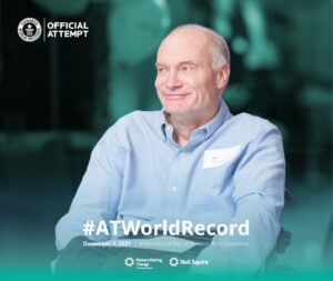 Picture: Neil Squire Executive Director Gary Birch in a wheelchair. Text: GUINNESS WORLD RECORDS official attempt, #ATWorldRecord on December 3rd, 2021, UN Day for People with Disabilities.