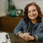 Neil Squire Prairie Regional Manager Nikki Langdon sitting at her desk